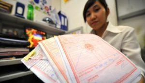Tội mua chuộc hoặc cưỡng ép người khác trong việc khai báo, cung cấp tài liệu
