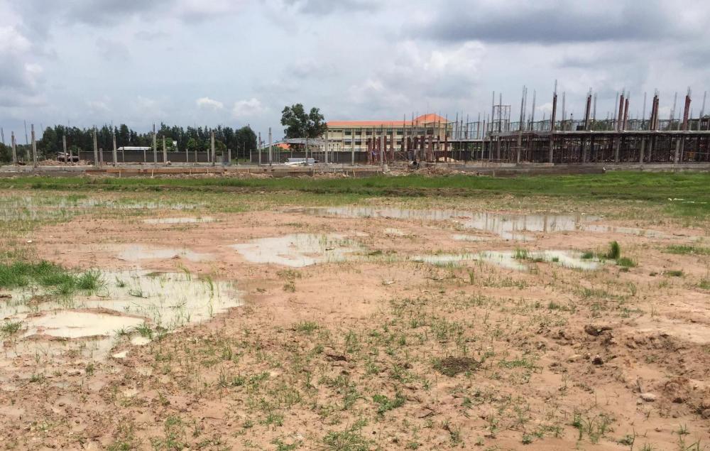 Nguyên tắc miễn giảm tiền sử dụng đất tại Quảng Ninh đối với người có công với Cách mạng được quy định như thế nào?